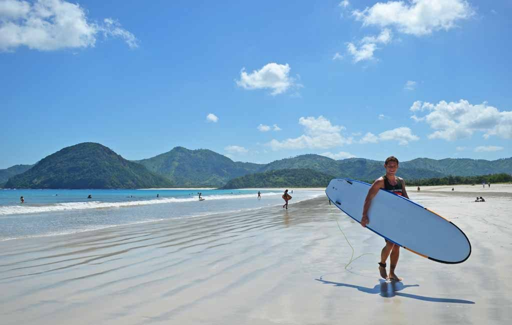 A surfer in Selong belenak beach 1024x650 Discovering the Most Exotic Lombok Island   Indonesia